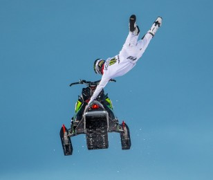 Heath Frisby competes in the snow mobile long jump at 2015 Winter X-Games.