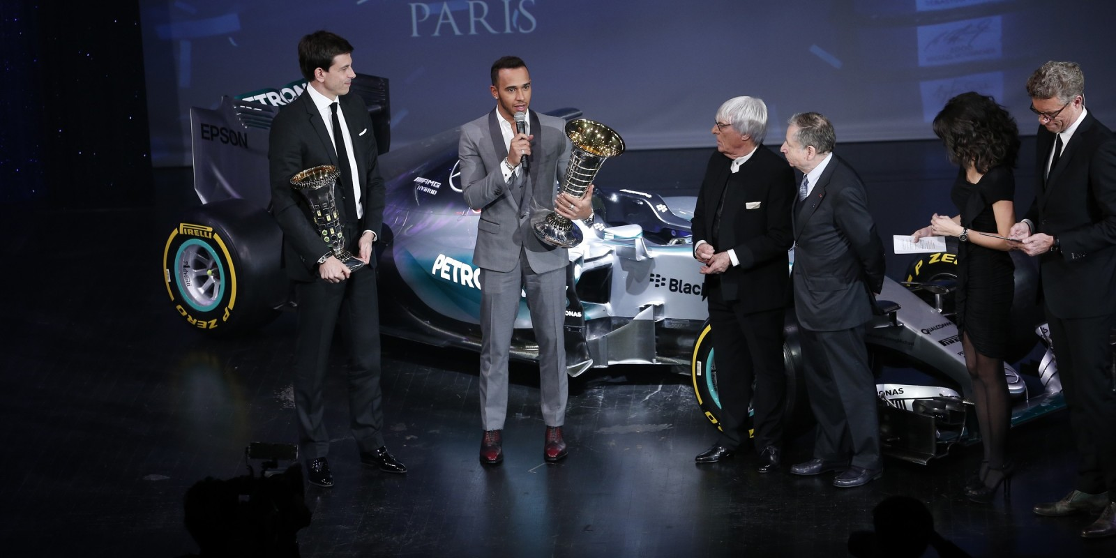Lewis Hamilton collecting the 2015 FIA Formula One Drivers Championship Trophy at the 2015 FIA Awards Gala in Paris