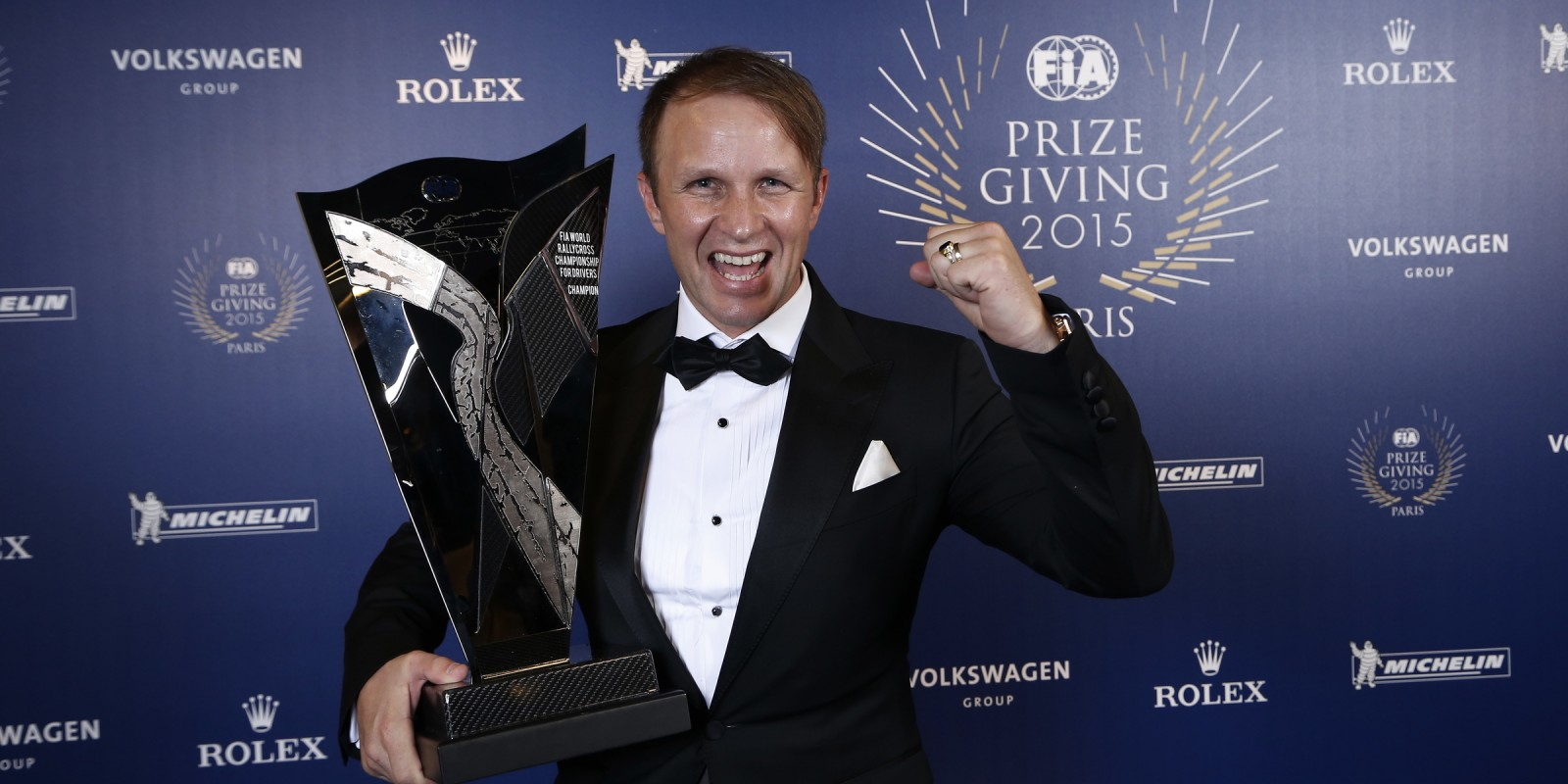 Petter Solberg collecting the 2015 FIA World Rallycross Drivers Championship Trophy at the 2015 FIA Awards Gala in Paris