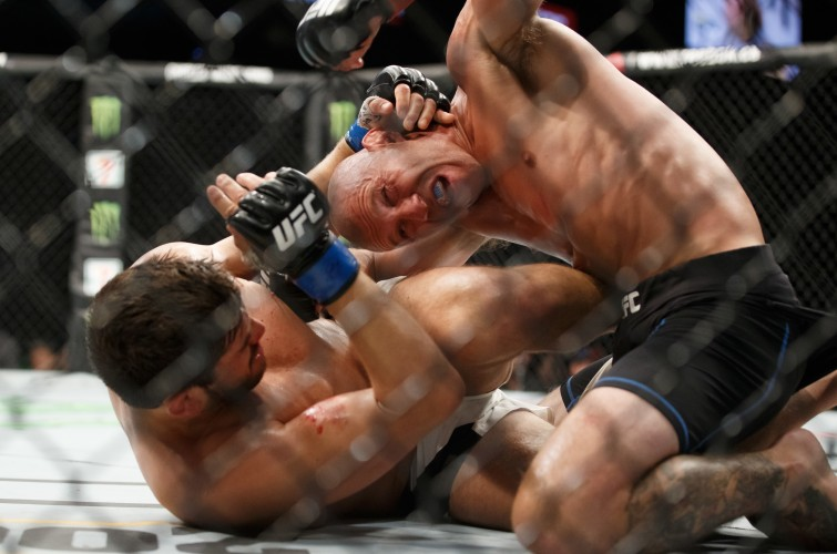 Donald Cerrone punches Patrick Cote in their welterweight bout during the UFC Fight Night event inside the TD Place Arena on June 18, 2016 in Ottawa, Ontario, Canada