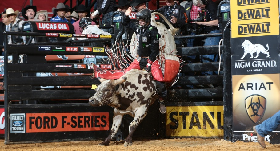 Derek Kolbaba rides DAM Cattle Co's Whiskey Trip for 86.5 during the first round of the Little Rock Built Ford Tough series PBR in Des Moines, IA