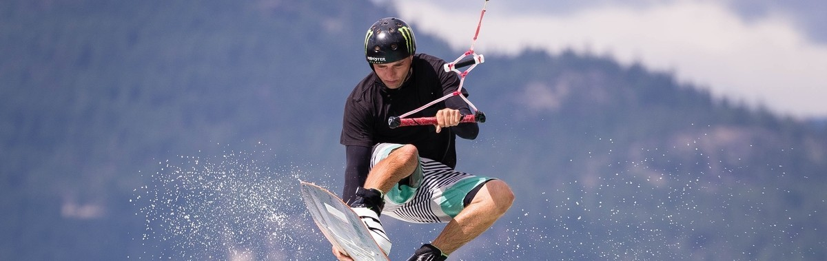 Action and lifestyle images of the Wake zone at Center of Gravity, Kelowna, featuring James Balzer and Kevin Henshaw