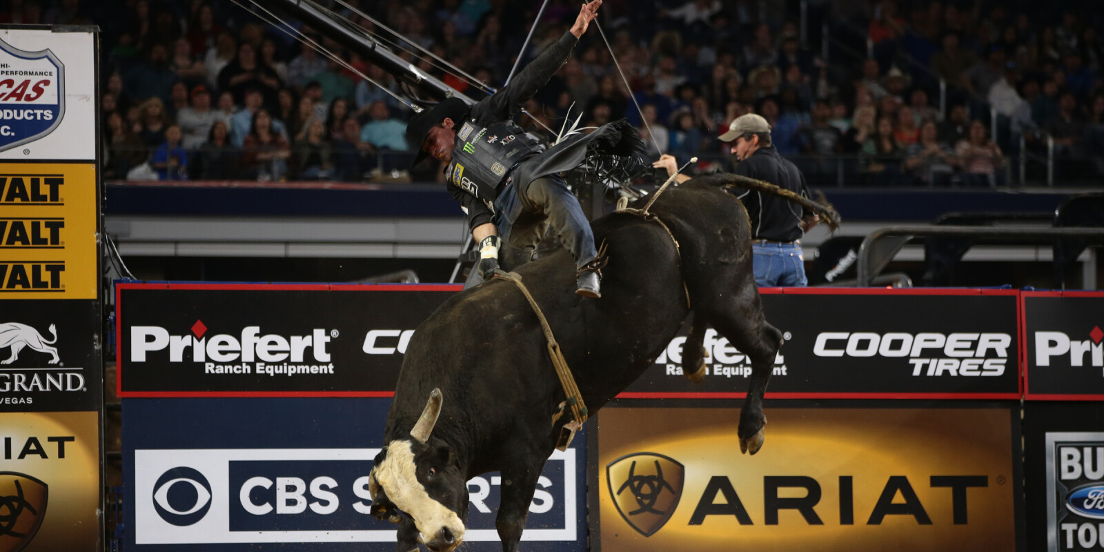 Guilherme Marchi attempts to ride Jeff Robinson Bucking Bulls's Walk Off during the first round of the Iron Cowboy, Built Ford Tough series PBR