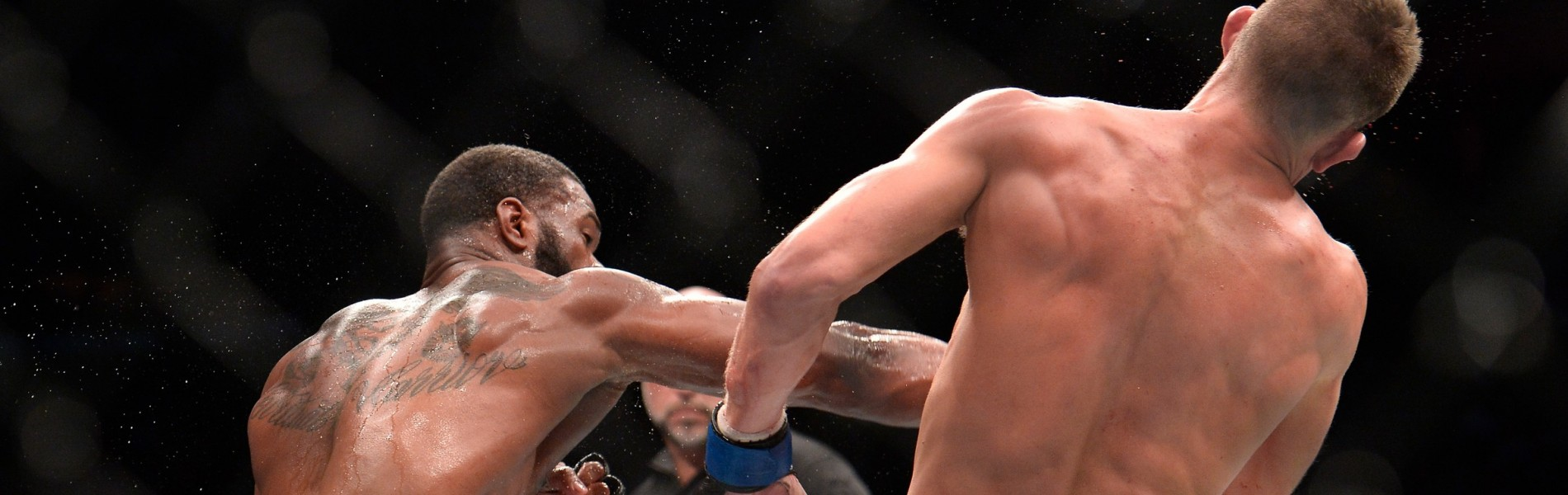 Tyron Woodley punches Stephen Thompson in their UFC welterweight championship bout during the UFC 205 event at Madison Square Garden on November 12, 2016 in New York City