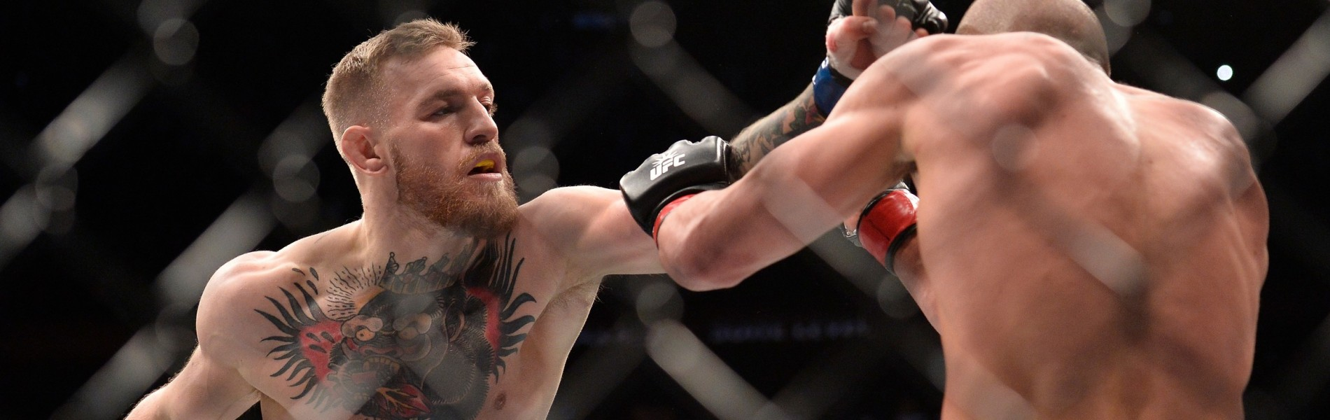Conor McGregor of Ireland punches Eddie Alvarez in their UFC lightweight championship fight during the UFC 205 event at Madison Square Garden on November 12, 2016 in New York City.