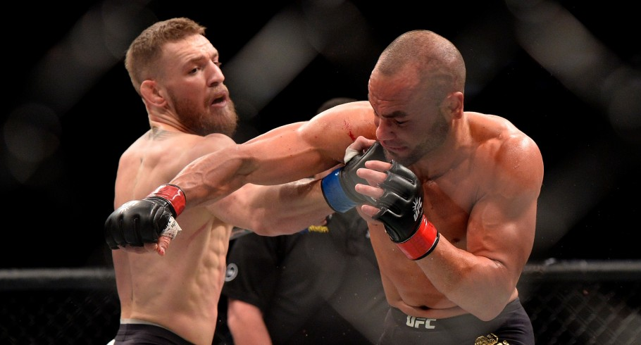 Conor McGregor of Ireland punches Eddie Alvarez in their UFC lightweight championship fight during the UFC 205 event at Madison Square Garden on November 12, 2016 in New York City
