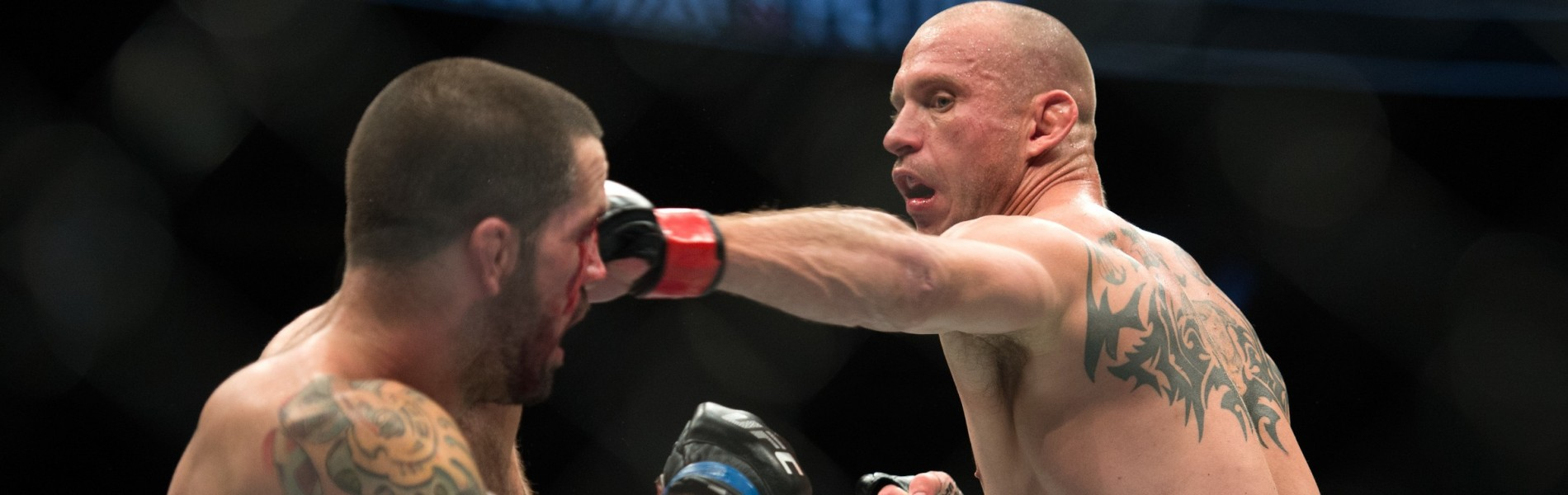Donald Cerrone punches Matt Brown in their welterweight bout during the UFC 206 event inside the Air Canada Centre on December 10, 2016 in Toronto, Ontario, Canada.