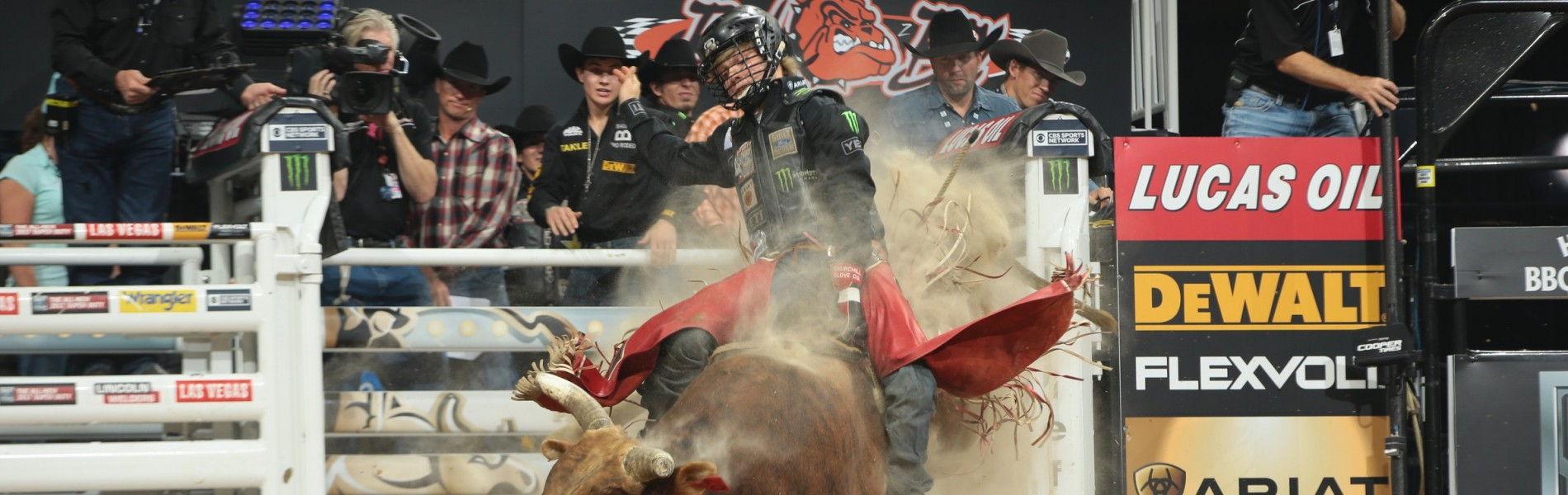 Derek Kolbaba attempts to ride Berger Bucking Bulls's Siouxper Stinger during the second round of the Built Ford Tough series PBR World Finals.