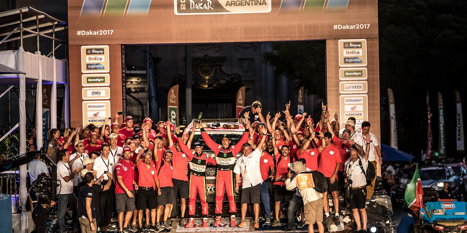 Nani Roma, Alex Haro and Team Overdrive on the podium after finishing 4th in the 2017 Dakar Rally