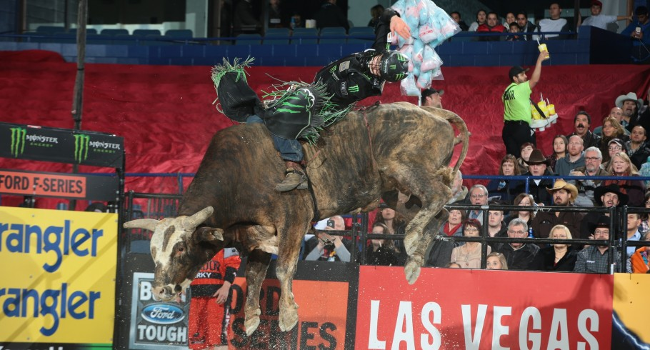 Derek Kolbaba attempts to ride Rocking I Rodeo Co's Machinery Auctioneer's Colonel during the first round of the Chicago Built Ford Tough series PBR