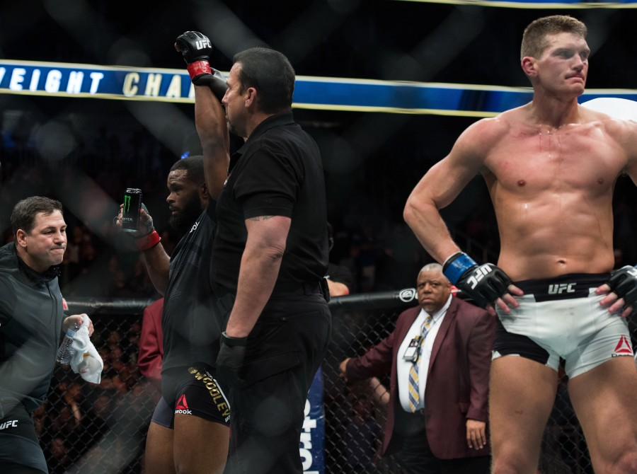 (L-R) Tyron Woodley celebrates his victory over Stephen Thompson in their welterweight championship bout during the UFC 209 event at T-Mobile arena on March 4, 2017 in Las Vegas, Nevada.