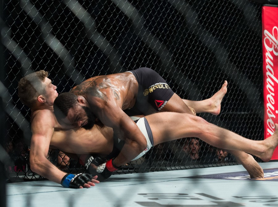 (R-L) Tyron Woodley takes down Stephen Thompson in their welterweight championship bout during the UFC 209 event at T-Mobile arena on March 4, 2017 in Las Vegas, Nevada.