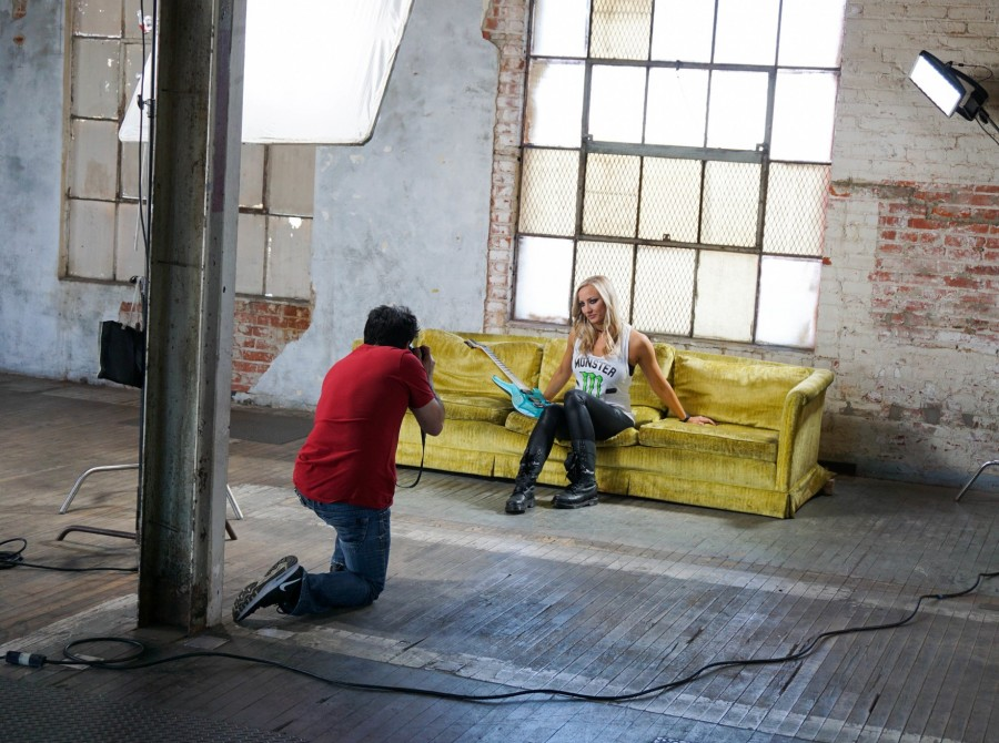 behind the scenes photos of Nita Strauss's photoshoot with Kevin Estrada