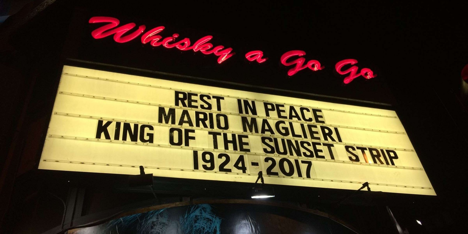 photos of the Whisky A Go Go venue marquee paying homeage to recently deceased owner Mario Maglieri