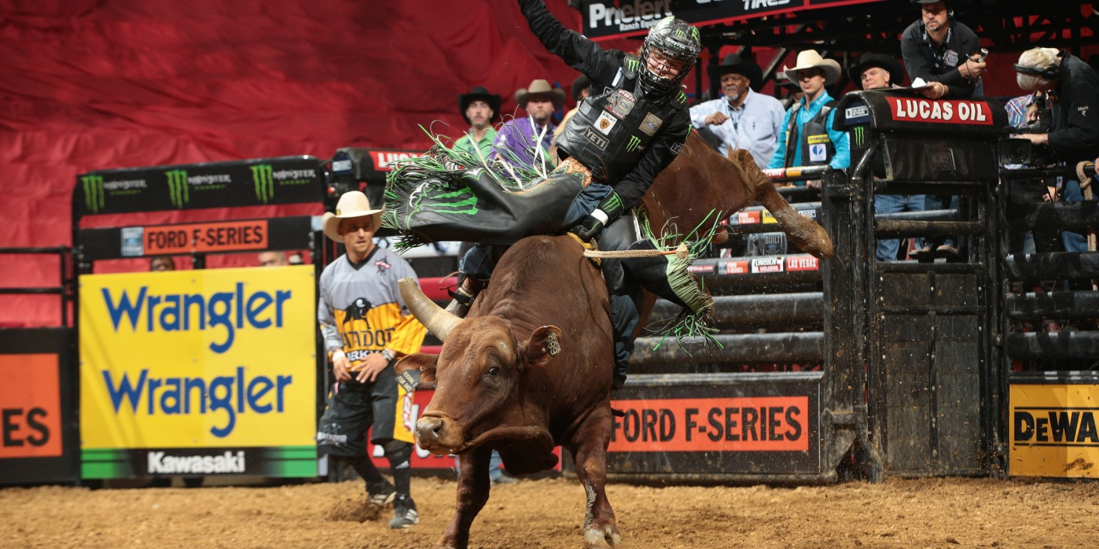 Derek Kolbaba attempts to ride Rocking I Rodeo Co's Billy Bat Skat during the third round of the St. Louis Built Ford Tough series PBR. Photo by Andy Watson