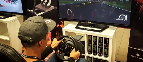 Krzysztof Holowczyc playing a racing video game at Good Game Expo 2016