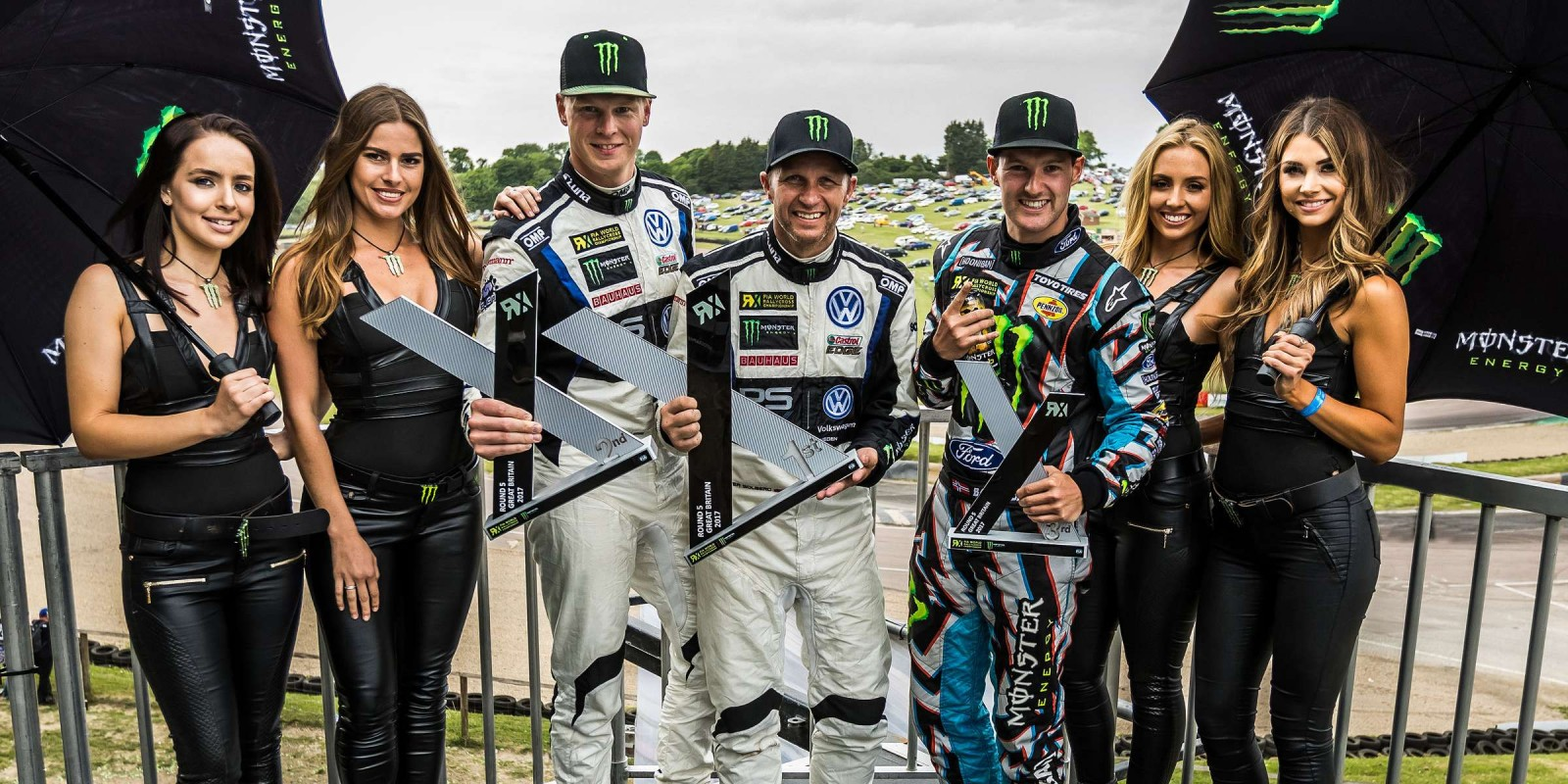 Petter Solberg, Johan Kristoffersson and Andreas Bakkerud celebrating a 1-2-3 result at the 2017 World RX of GB