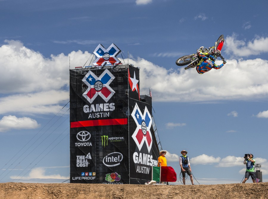 Monster riders compete in the Freestyle best whip competition in the 2016 Summer X-Games in Austin, Texas.