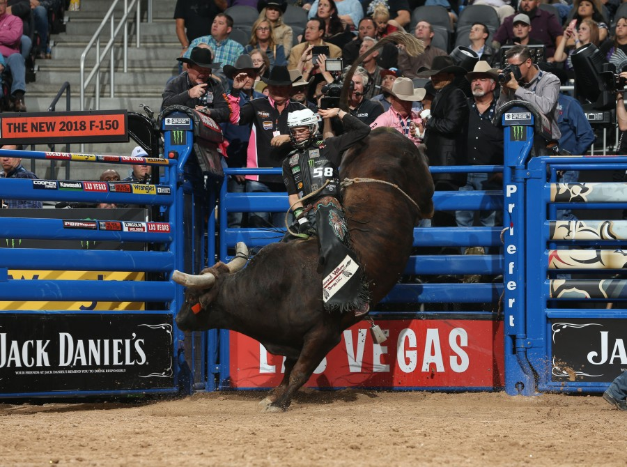Gage Gay rides Dakota Rodeo/Julie Rosen/Clay Struve/Chad Berger's during the second round of the Built Ford Tough series PBR World Finals.