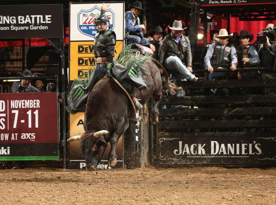 Jose Vitor Leme attempts to ride Broken Arrow Bucking Bulls's Twinkle Toes during the second round of the New York City Unleash the Beast PBR.