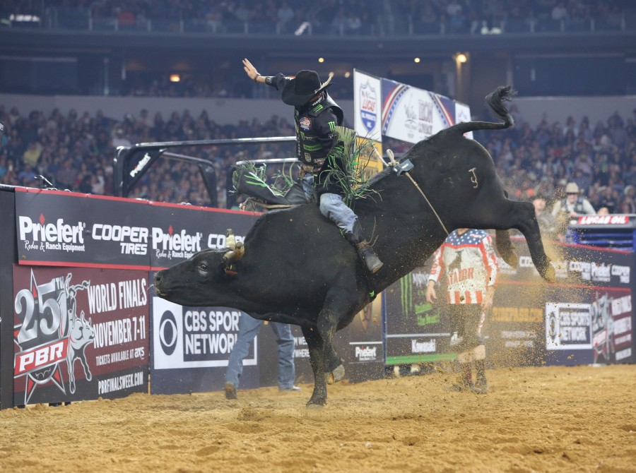 JB Mauney rides Dakota Rodeo/Chad Berger/Clay Struve's Shelly's Gangster for 87.75 during the Arlington Last Cowboy Standing PBR 25th Anniversary Unleash the Beast.