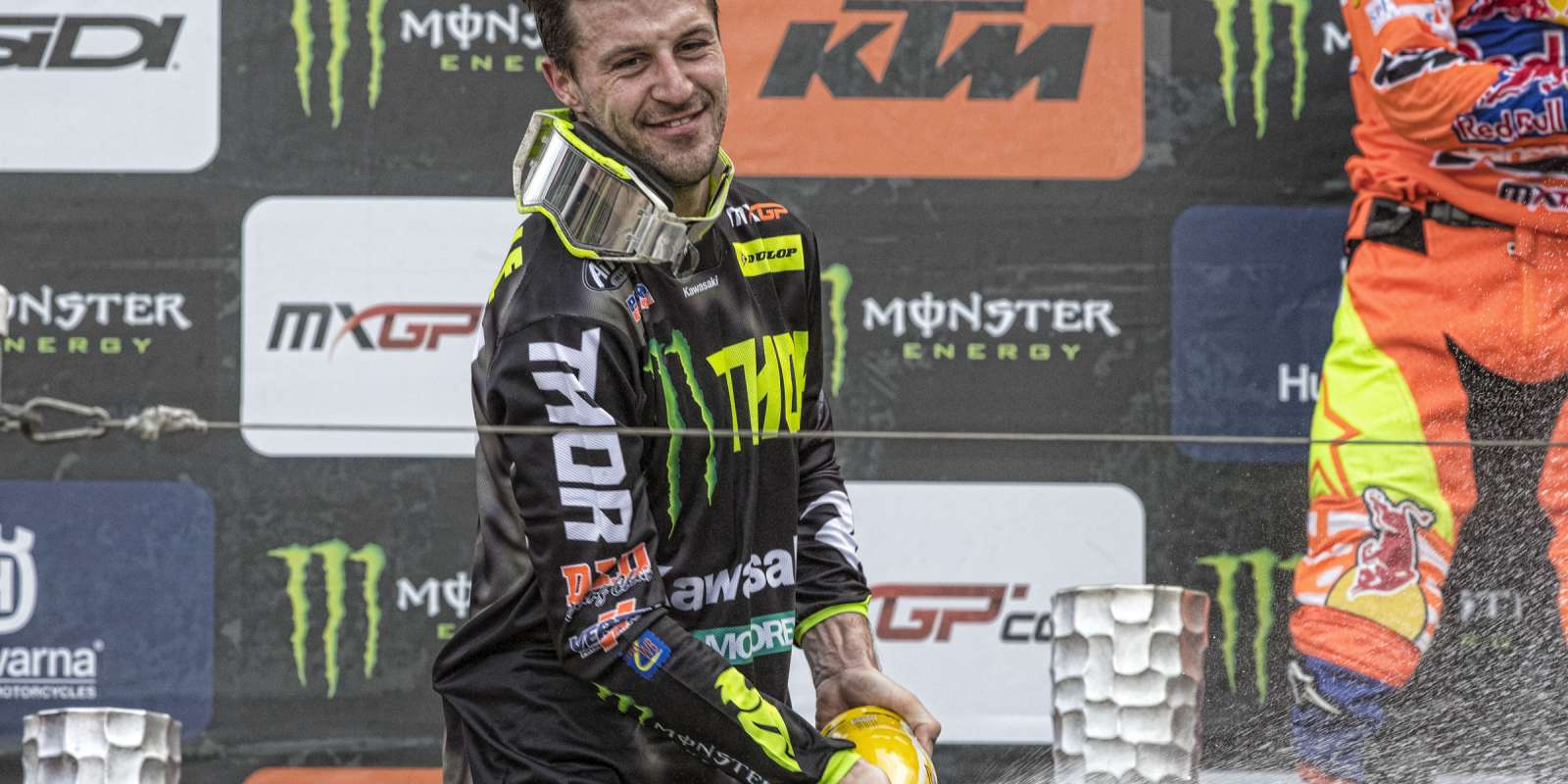 Clement Desalle celebrating on the podium of 2018 MXGP Trentino
