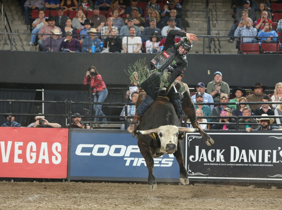 Derek Kolbaba attempts to ride X6 Ranch Bucking Cattle's Pennywise during the third round of the Billings PBR 25th Anniversary Unleash the Beast