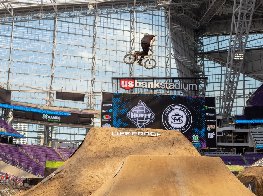 Monster athletes compete in the 2018 BMX Dirt competition