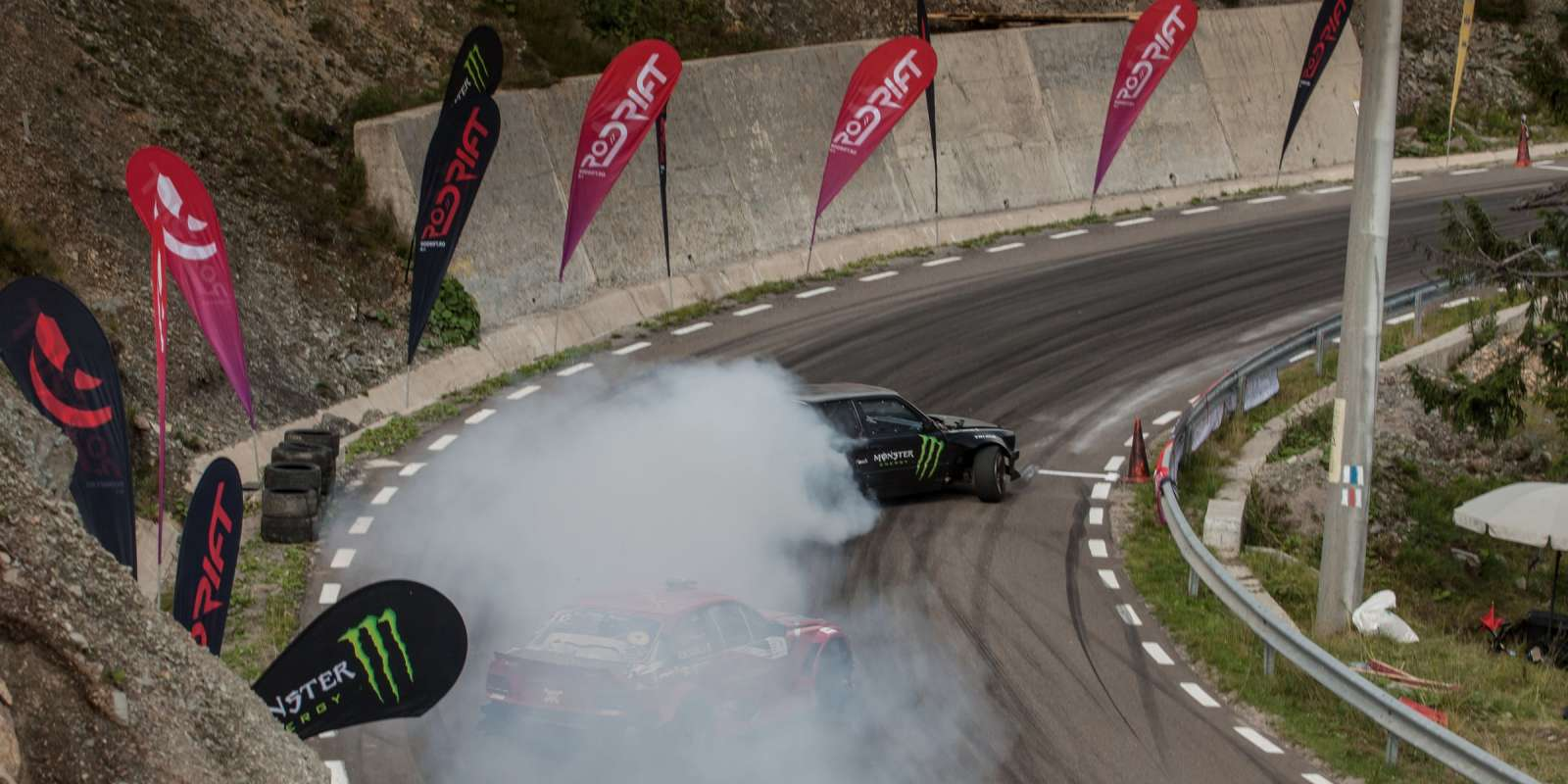 Event imagery taken at the 4th stage of the Romanian Drift Championship. We have valid contracts with both the event and one of the riders in the images (black branded car). The contracts are uploaded in this file also. The name of the other athletes have