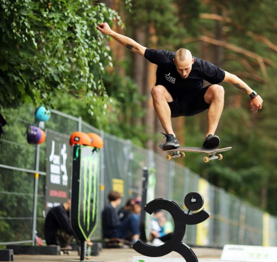 Rock and metal music festival - Devilstone. Monster Energy area with a mini ramp and bmx&skate sessions and barber shop. The guy in the photo - Justinas Ivoška