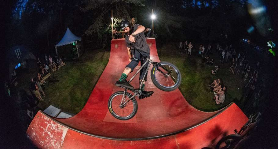 Rock and metal music festival - Devilstone. Monster Energy area with a mini ramp and bmx&skate sessions and barber shop. the bmx guy - karolis lamsargis
