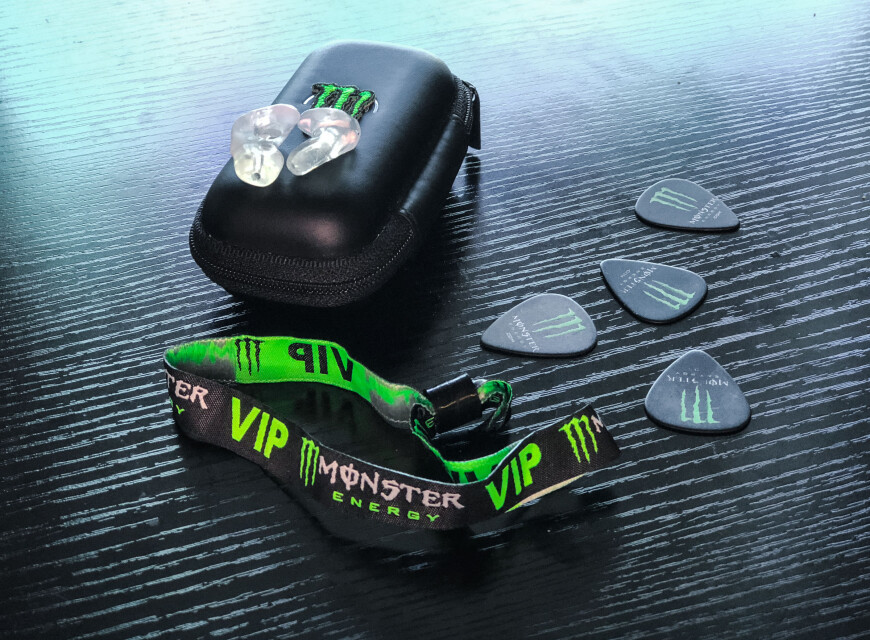 ear plugs, guitar picks and vip wristband for news article