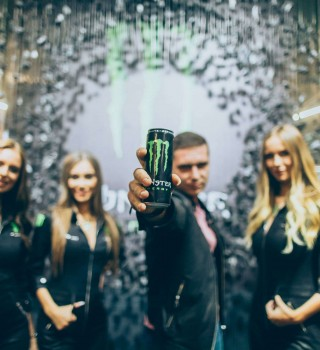 Monster Energy product launch party in Kiev, Ukraine - a guest with a can and Monster Girls