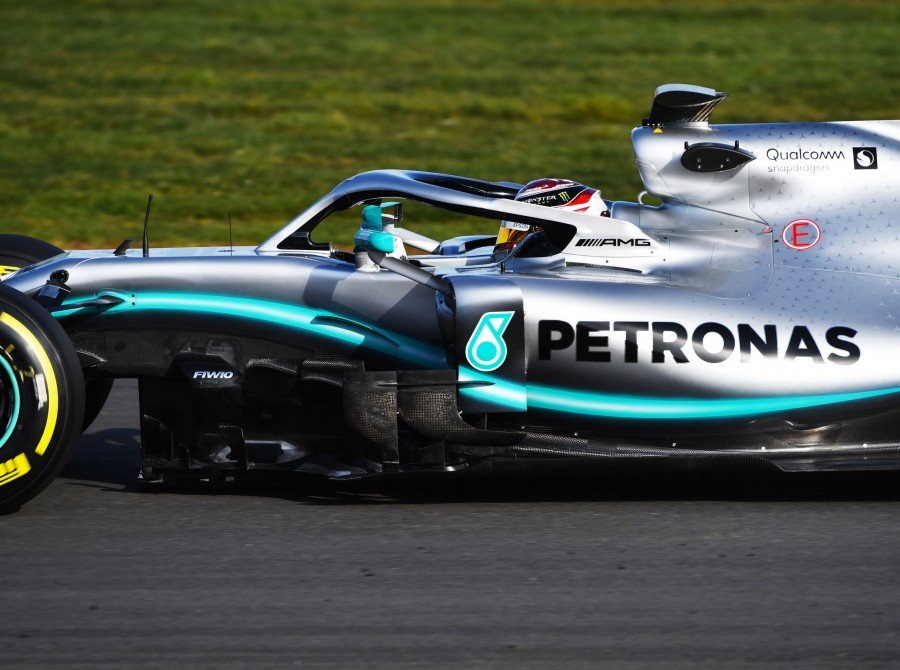 Images of Lewis Hamilton driving the Mercedes-AMG Petronas W10