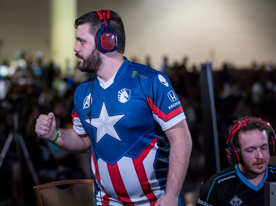 Photo of Hungrybox popping off after winning his fourth CEO title in a row. He takes first place over Wizzrobe from Team Envy.