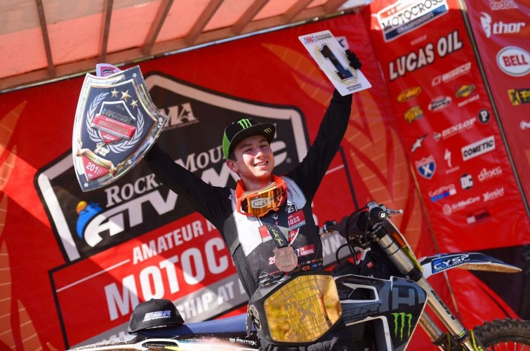 Photo of Hardy Munoz celebrating his 1st place at Loretta Lynn MX Amateur Championship.
