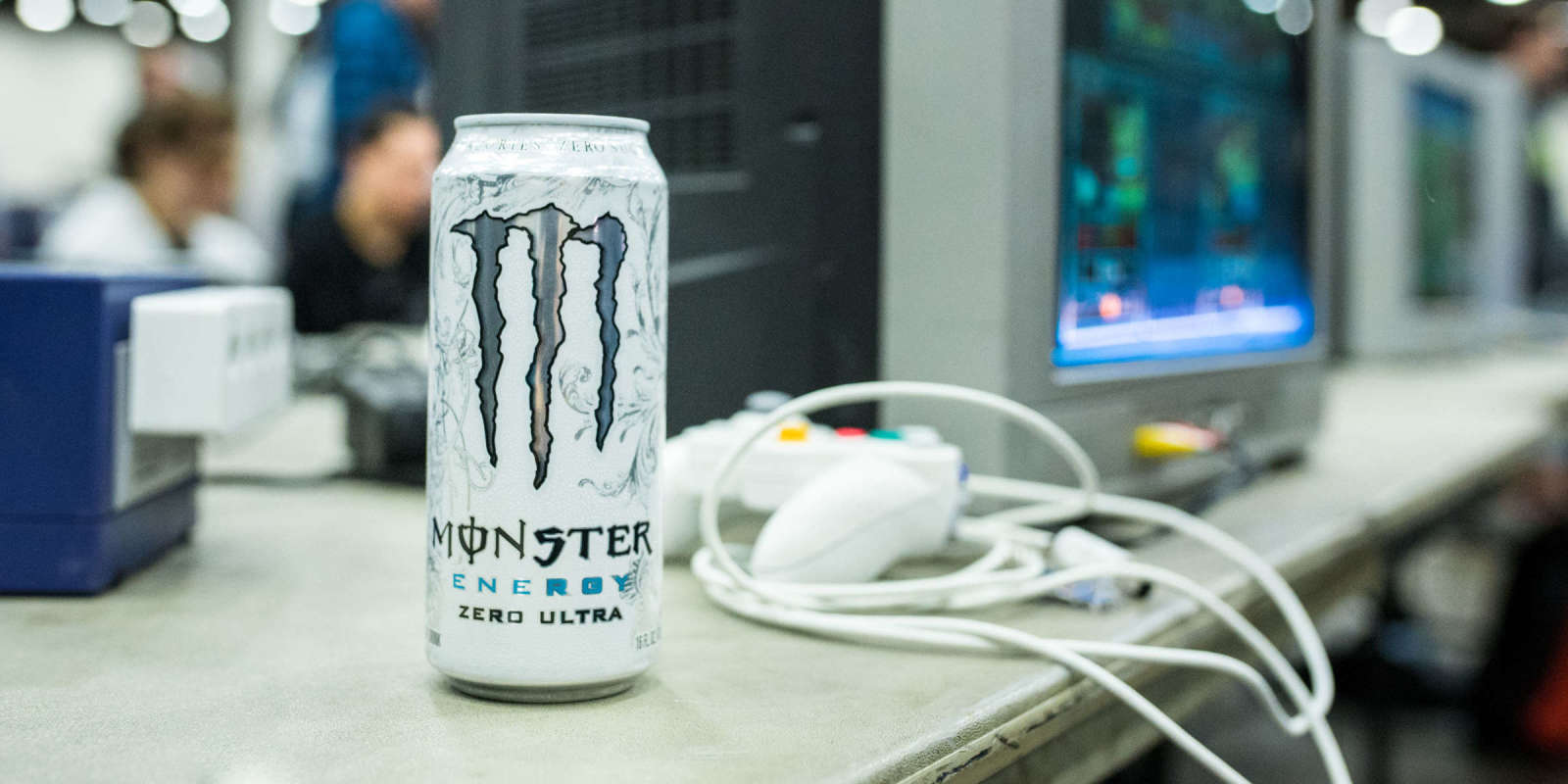 Photo of a Monster can next to a Gamecube gaming setup