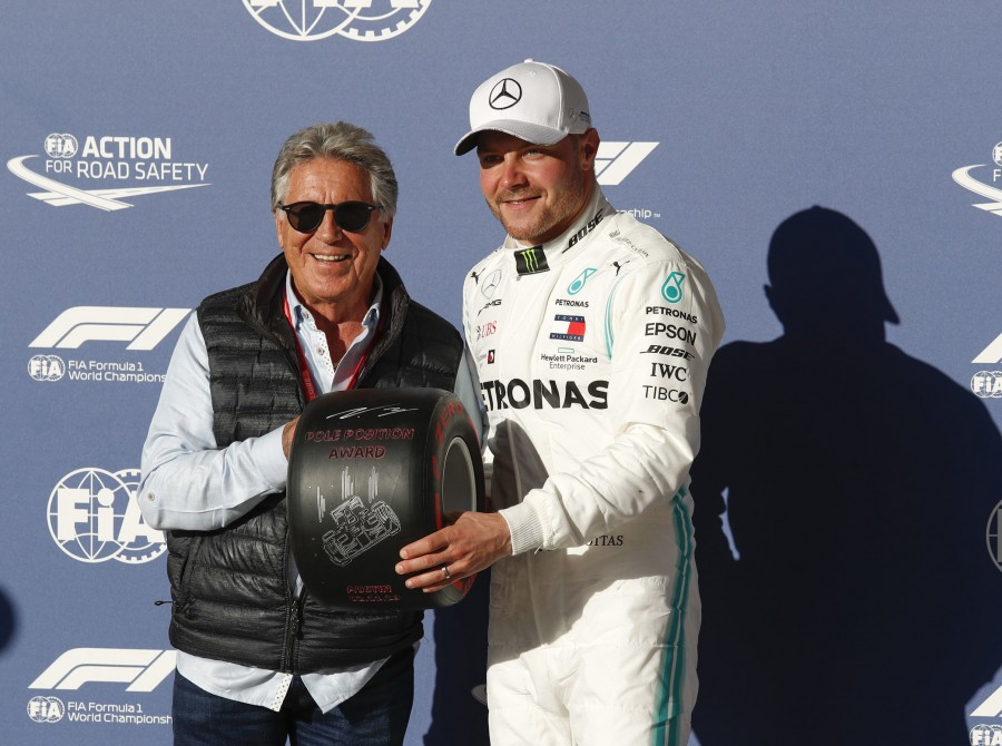 Valtteri Bottas receiving the Pole Position award at the 2019 US Grand Prix - presented by Mario Andretti