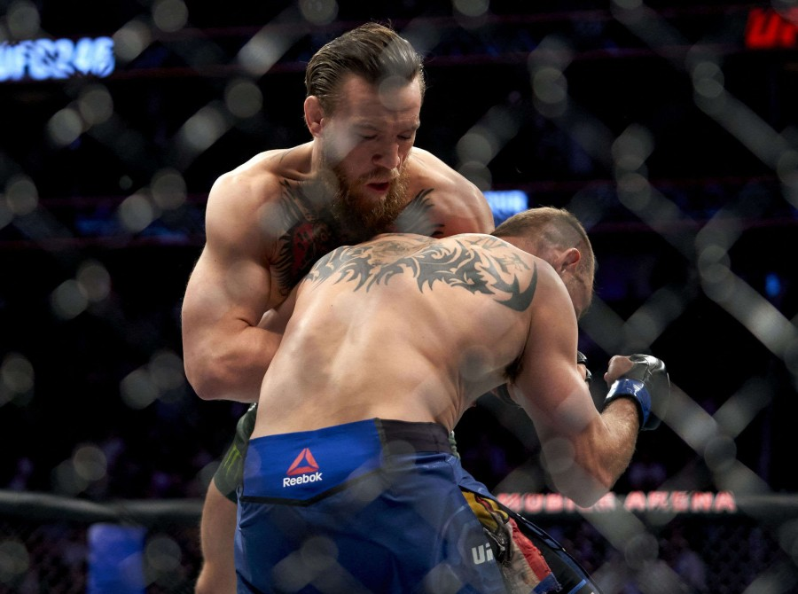 Conor McGregor and Donald Cerrone during the UFC 246 fight at the Park Theater on January 17, 2020 in Las Vegas, Nevada.
