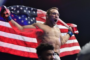 Michael Chandler battles Dan Hooker during the UFC 257 event at UFC Fight Island on January 23, 2021 in Abu Dhabi, United Arab Emirates.